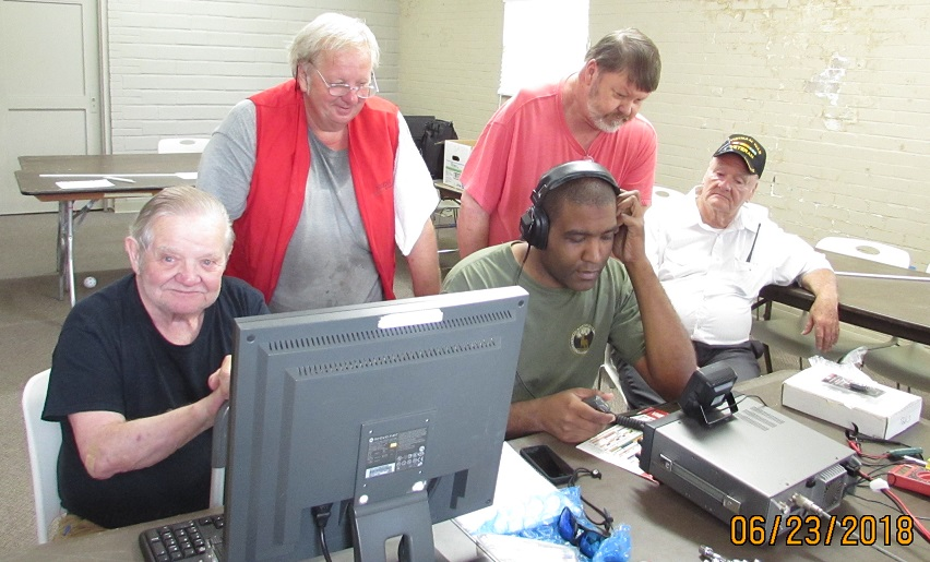 1A W5WQ F D operating station l to r seated Bob K5DWI, Patrick KD5JXD and William KG5AAB standing l to r Jeffery N5ZNT and Donnie KD5RGT
